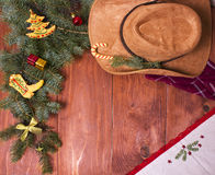 Cowboy Christmas wood background with holiday decorations Royalty Free Stock Images