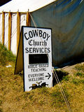Cowboy church service. S sign outside tent royalty free stock photography