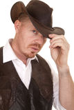 Cowboy close vest hand on hat serious Stock Image