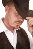 Cowboy close vest hat look down touch hat Stock Image