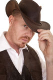 Cowboy close vest hat look serious touch hat Royalty Free Stock Photo