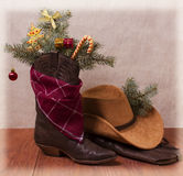 Cowboy clothes with Christmas objects Royalty Free Stock Photos