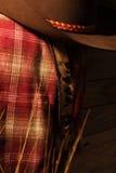 Cowboy Clothes illuminé par la lampe à pétrole Photo stock