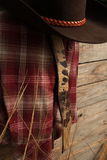 Cowboy clothes on wooden fence Royalty Free Stock Photography