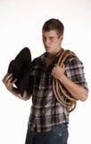 Cowboy con il cappello nero Fotografie Stock Libere da Diritti