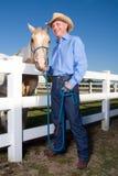 Cowboy con il cavallo - verticale Fotografia Stock Libera da Diritti