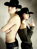 Cowboy couple. Sheriff woman and cowboy man stock photography
