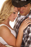 Cowboy couple close white top eyes closed Stock Photography