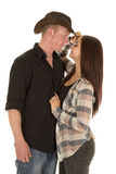 Cowboy couple faces close touch hat Royalty Free Stock Image