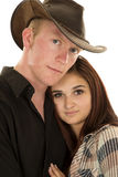 Cowboy couple her head on his chest look Royalty Free Stock Photos