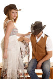 Cowboy couple him sit her stand Royalty Free Stock Photo