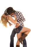 Cowboy couple lean back kiss neck Royalty Free Stock Photos