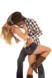 Cowboy couple lean back kiss neck Royalty Free Stock Photos