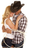 Cowboy couple rope around them close Royalty Free Stock Image