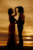 Cowboy couple silhouette her hand his hat Stock Photography