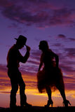 Cowboy couple silhouette man hand on hat Royalty Free Stock Photo