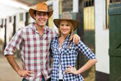 Cowboy couple stables Stock Photo