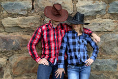 Cowboy couple under hats Stock Images