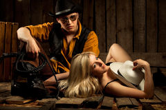 Cowboy with cowboy girl Stock Images