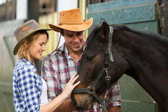 Cowboy cowgirl comforting horse Royalty Free Stock Photo