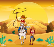 A cowboy and a cowgirl at the desert Stock Images