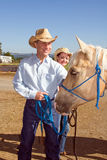 Cowboy, Cowgirl, and Horse - Vertical Royalty Free Stock Image