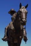 Cowboy de bronze Fotografia de Stock Royalty Free