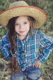 Cowboy de petite fille de portrait Images libres de droits