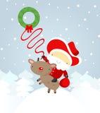 Cowboy de Santa avec un lasso Images stock