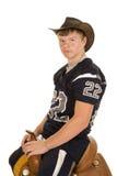 Cowboy in de zitting van voetbaljersey op zadel royalty-vrije stock foto