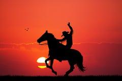 Cowboy del rodeo al tramonto Immagine Stock