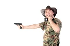 The cowboy with the delayed pistol isolated. The young bearded cowboy with the delayed pistol and a small lamp Royalty Free Stock Photo