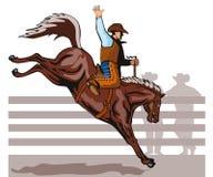 Cowboy, der ein sträubendes wildes Pferd reitet Lizenzfreie Stockfotografie