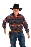 Cowboy, der für seine Gewehr erreicht. Lizenzfreie Stockfotos