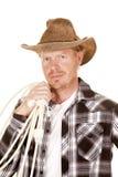 Cowboy, der Seil über der Schulter schaut nah hält Stockfotos