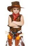Cowboy des kleinen Mädchens, der mit den gefalteten Händen steht Lizenzfreies Stockfoto