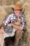 Cowboy dog hay Stock Images