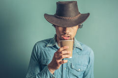 Cowboy drinking coffee Royalty Free Stock Photography