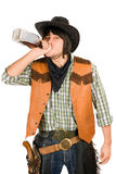 Cowboy drinking whiskey Stock Images