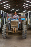 Cowboy driving tractor Royalty Free Stock Images