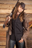 Cowboy duster long hair rifle on shoulder look Stock Images