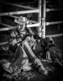 Cowboy ed il suo cane Fotografie Stock