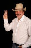 Cowboy effectuant le signe de victoire images stock