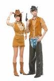 Cowboy en veedrijfster met kanon Stock Afbeeldingen
