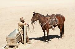 Cowboy en zijn paard Stock Afbeeldingen
