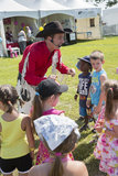 Cowboy entertainer. Dan coboy entertainer with children during woodstock family event the 5-6 July at ste-julie, quebec, canada Royalty Free Stock Photography