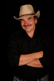 Cowboy envelhecido médio de sorriso imagem de stock royalty free