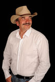 Cowboy envelhecido médio de sorriso Fotos de Stock Royalty Free