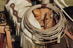 Cowboy Equipment. Closeup of cowboy in saddle with lasso Royalty Free Stock Image