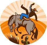 Cowboy falling horse in desert. Illustration of a cowboy falling off horse in the desert done in retro woodcut style Stock Photography